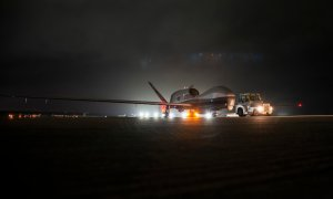 An MQ-4C Triton unmanned aircraft system (UAS) idles on a runway at Andersen Air Force Base, Guam after arriving for a deployment as part of an early operational capability (EOC) test. US Navy Photo