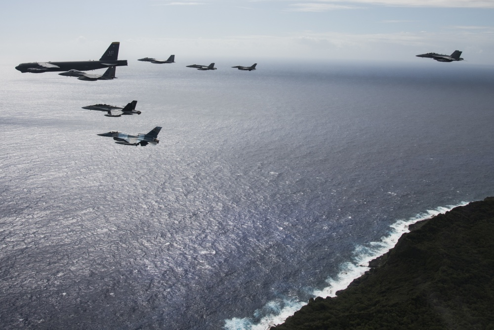 An 8-ship joint coalition formation flies over Guam during Exercise Cope North 20, near Andersen Air Force Base, Feb. 19, 2020.