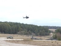 An AH-64 Apache helicopter pilot circles the training area during training exercise Combined Resolve XIII at the Joint Multinational Readiness Center, Hohenfels, Germany.