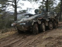 A Dutch GTK Boxer maneuvers through muddy terrain during Combined Resolve XIII at the Hohenfels Training Area in Hohenfels, Germany.