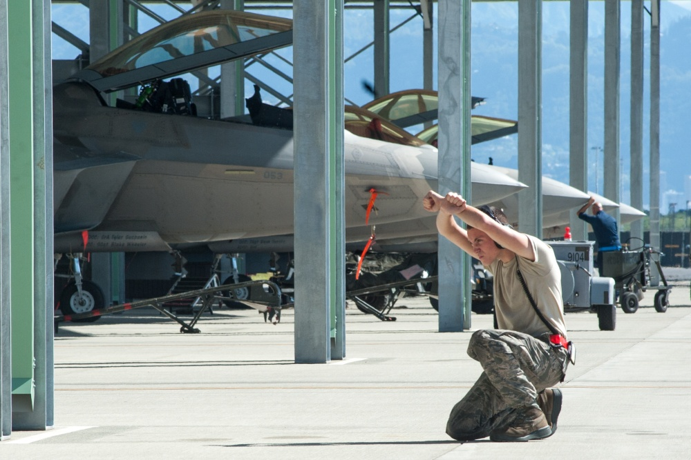 Airman 1st Class Jordan Partin, 15th Aircraft Maintenance Squadron crew chief, marshals in an F-22 Raptor Jan. 30, 2020, at Joint Base Pearl Harbor-Hickam, Hawaii.