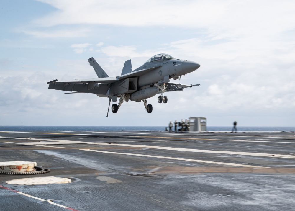 "An F/A-18F Super Hornet, attached to ""Black Lions"" of Strike Fighter Squadron (VFA) 213, lands on USS Gerald R. Ford's (CVN 78) flight deck during flight operations. Ford is currently underway conducting its flight deck and combat air traffic control center certifications. (U.S. Navy photo by Mass Communication Specialist 3rd Class Zachary Melvin)"