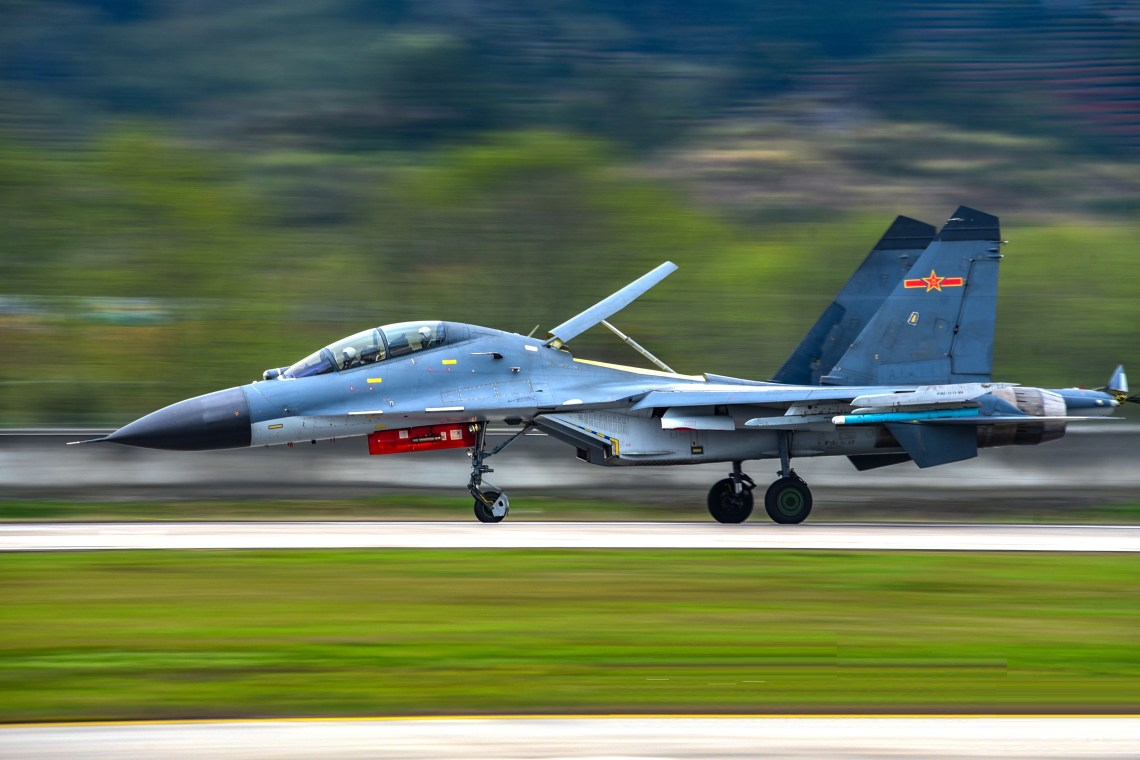 Chinese People's Liberation Army Air Force (PLAAF) Shenyang J-11 Air superiority fighter taxies on the tarmac in speed before takeoff for a real combat flight training exercise on March 10, 2020. (eng.chinamil.com.cn/Photo by Fu Gan)