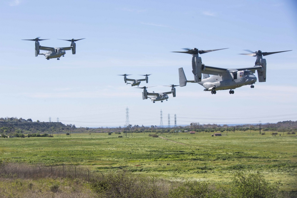 Four MV-22B Ospreys assigned to Marine Tiltrotor Squadron (VMM) 362, Marine Aircraft Group (MAG) 16, 3rd Marine Aircraft Wing (MAW), land near a simulated weapons engagement zone during an air assault in support of 1st Battalion, 3rd Marine Regiment, at Camp Pendleton, Calif., Feb. 26, 2020.