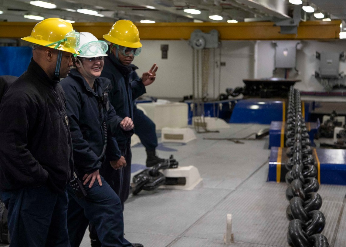 Sailors assigned to the deck department of the aircraft carrier USS Gerald R. Ford (CVN 78) participate in an anchoring evolution in the ship's forecastle.