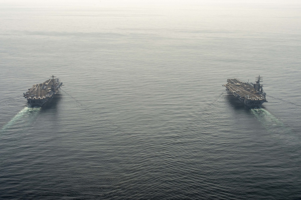 The aircraft carriers USS Dwight D. Eisenhower (CVN 69), right, and USS Harry S. Truman (CVN 75) transit the Arabian Sea March 18, 2020.