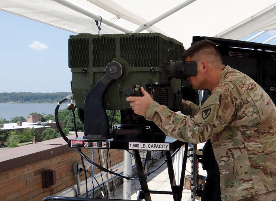 A soldier views the 3rd GEN FLIR system's capabilities. The system enables greater speed, precision and range in the targeting process.