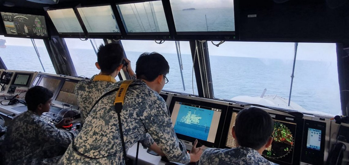 The Republic of Singapore Navy  personnel on board RSS Independence, monitoring the Sam Jaguar.