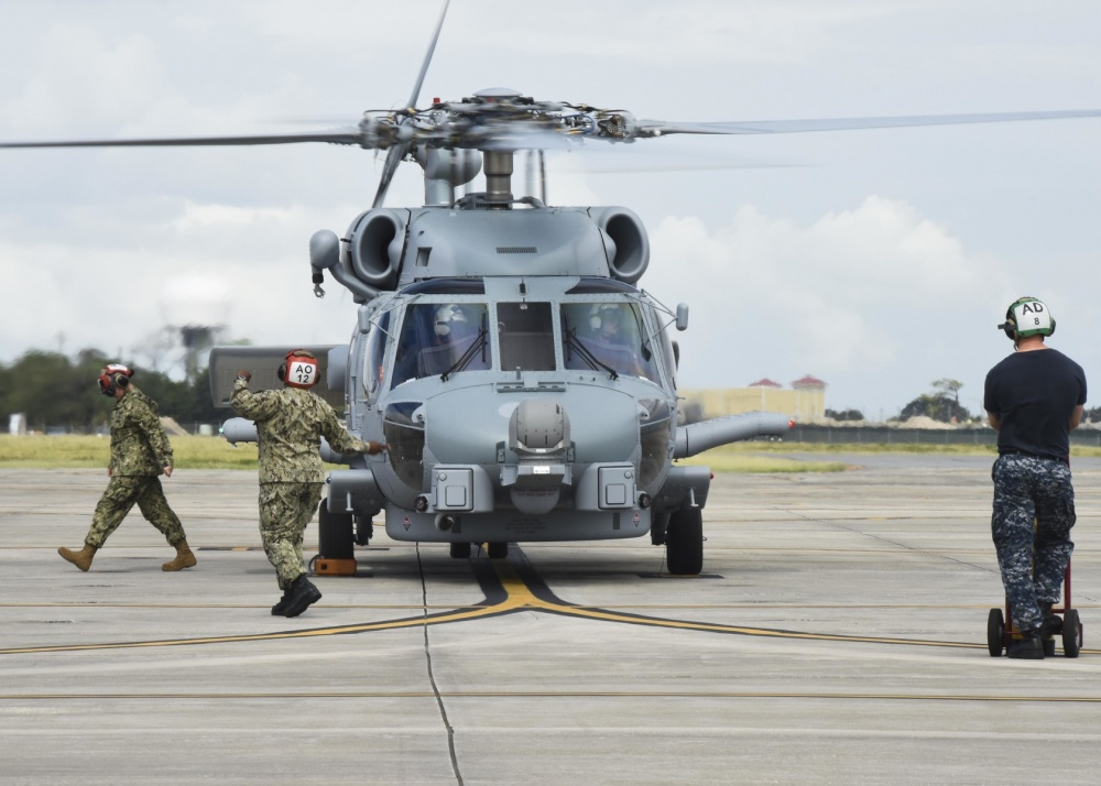An MH60-R Sea Hawk helicopter, recently purchased by the Royal Saudi Arabian Navy, is directed on the flight line at Naval Station Mayport. The helicopter is the first of a series of aircraft that will be used by the U.S. Navy to train Saudi pilots and their crews. (U.S. Navy photo by Mass Communication Specialist 1st Class Brian G. Reynolds/Released)