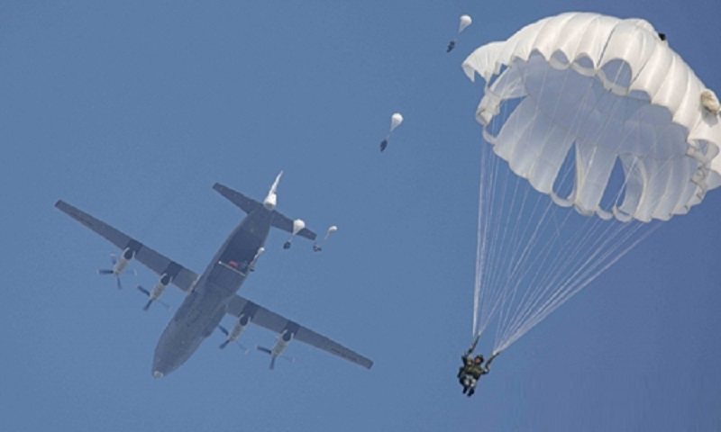 Chinese PLA Air Force Paratroopers hold fully armed parachute jump exercises