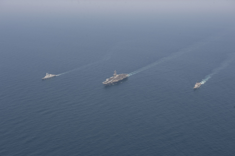 The aircraft carrier USS Dwight D. Eisenhower (CVN 69), center, the guided-middle cruiser USS San Jacinto (CG 56), left, and the French anti-air frigate Forbin (D620) conduct a group-sail exercise in the Arabian Sea, April 25, 2020. Ike, San Jacinto and Forbin are operating under national tasking, as they participate in a bilateral, interoperability exercise to strengthen partnership between the U.S. and French navies. (U.S. Navy photo by Mass Communication Specialist 3rd Class Sophie A. Pinkham)