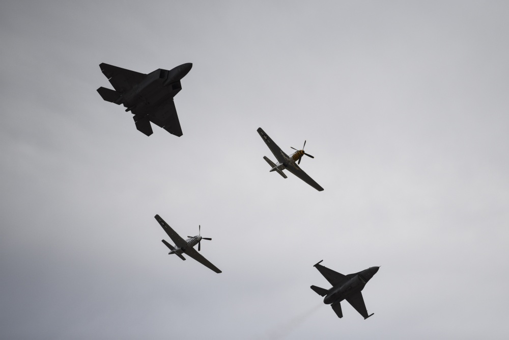 A U.S. Air Force F-22 Raptor, assigned to the F-22 Demonstration Team, two P-51 Mustangs and an F-16 Viper, assigned to the F-16 Viper Demonstration Team, fly in formation during the 2020 Heritage Flight Training Course at Davis-Monthan Air Force Base, Arizona, Mar. 1, 2020. HFTC displays modern fighter and attack aircraft flying alongside World War II, Korea and Vietnam-era planes in a dramatic display of our nation's air power history. (U.S. Air Force photo by Senior Airman Mya M. Crosby)
