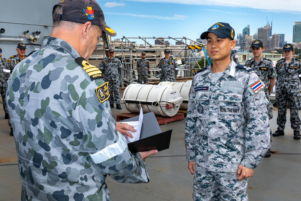 Midshipman Theeratiphong Pannil of the Royal Thai Navy is promoted to the rank of Sub Lieutenant by Commanding Officer HMAS Choules, Commander Scott Houlihan RAN, CSM at a ceremony held aboard HMAS Choules, Garden Island, Sydney.
