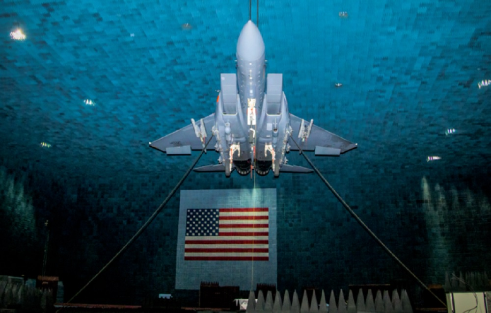 An F-15E Eagle is suspended from the ceiling at the Benefield Anechoic Facility during its first phase of testing of the Eagle Passive/Active Warning and Survivability System (EPAWSS) at Edwards Air Force Base, California, May 8, 2019. A testing phase began recently and is currently under way. (Air Force photo by Ethan