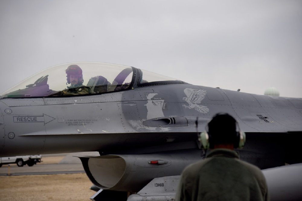 U.S. Air Force Capt. Peter Magness, 13th Fighter Squadron electronic combat pilot, Misawa Air Base, Japan, parks his F-16 Fighting Falcon after Exercise PACIFIC WEASEL, Friday, March 27, 2020. The 35th Fighter Wing began executing the PAC WEASEL exercises in 2018, and each iteration has been refined and improved upon since its inception. On 27 March, U.S. Air Force members had the opportunity to integrate with Japan Ground Self-Defense Force members and assets. (U.S. Air Force photo by Tech. Sgt. Chris Jacobs)