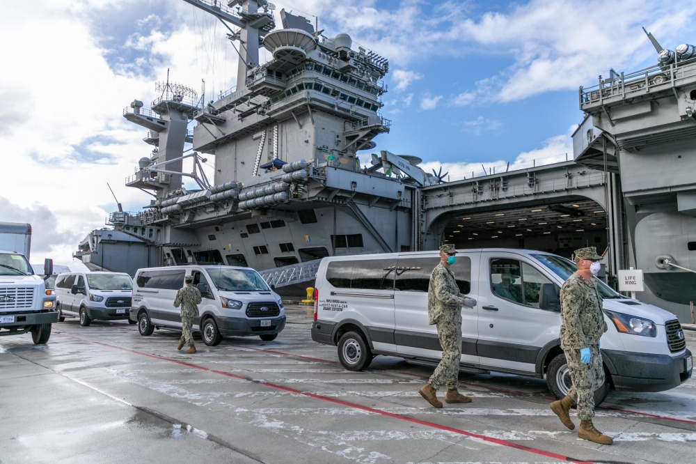 Seabees assigned to Naval Mobile Construction Battalion (NMCB) 1 and NMCB 5 coordinate transportation of Sailors assigned to the aircraft carrier USS Theodore Roosevelt (CVN 71) who have tested negative for COVID-19 and are asymptomatic from Naval Base Guam to Government of Guam and military-approved commercial lodging.