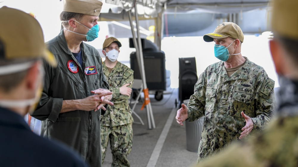 Vice Admiral Bill Merz, commander, U.S. 7th Fleet, meets with the staff and crew of the aircraft carrier USS Theodore Roosevelt (CVN 71). Merz arrived in Guam to assess and support the ongoing recovery efforts of the crew of USS Theodore Roosevelt, April 5. US Navy Photo by Mass Communication Specialist 1st Class Julio Rivera