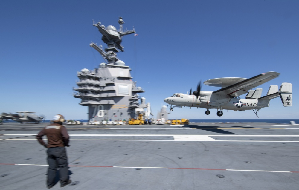 """An E2-D Advanced Hawkeye, attached to the """"Greyhawks"""" of Carrier Airborne Early Warning Squadron (VAW) 120, lands on USS Gerald R. Ford's (CVN 78) flight deck during flight operations April 2, 2020. Ford is underway in the Atlantic Ocean conducting carrier qualifications. (U.S. Navy photo by Mass Communication Specialist 3rd Class Brett Walker)"""