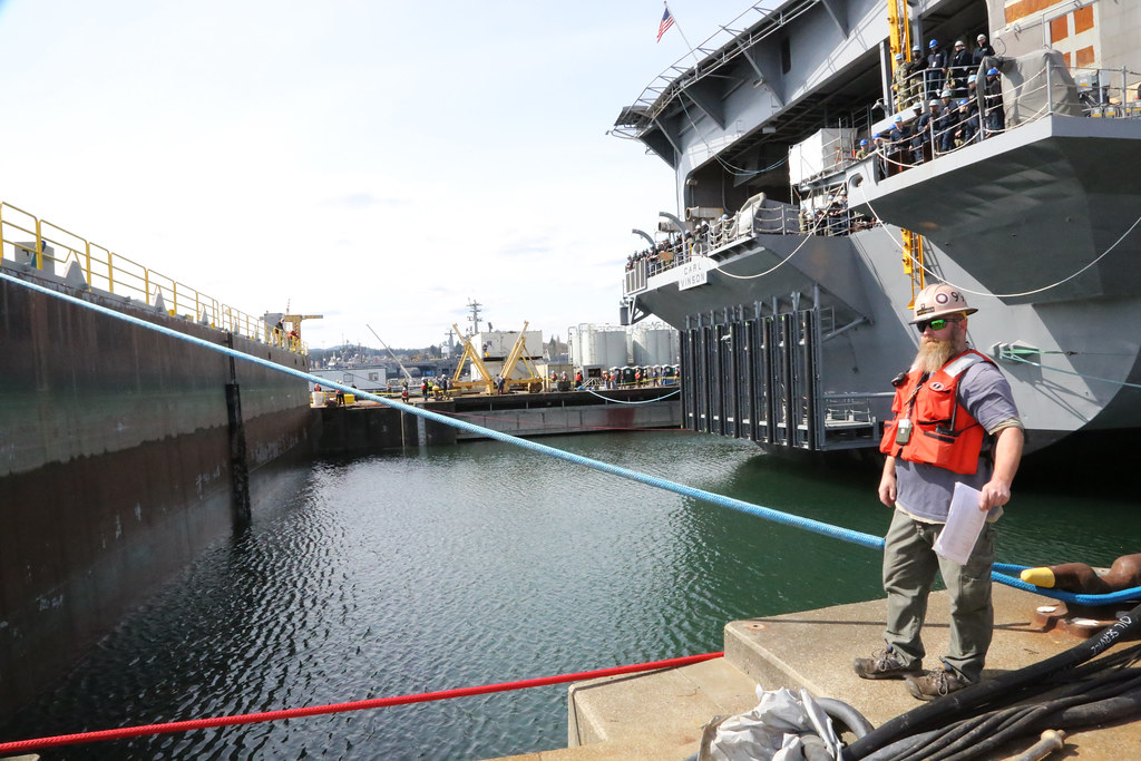 The Nimitz-class aircraft carrier USS Carl Vinson (CVN 70) prepares to depart Dry Dock 6 after spending 14 months undergoing a Docking Planned Incremental Availability period at Puget Sound Naval Shipyard & Intermediate Maintenance Facility.