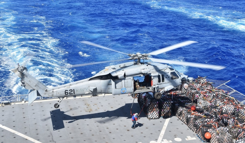 An MH-60S Sea Hawk helicopter prepares to lift supplies from the flight deck of the Lewis and Clark-class dry cargo and ammunition ship USNS Richard E. Byrd (T-AKE 4) during a replenishment-at-sea with U.S. 7th Fleet flag ship USS Blue Ridge (LCC 19). (U.S. Navy photo by Charles Baker)