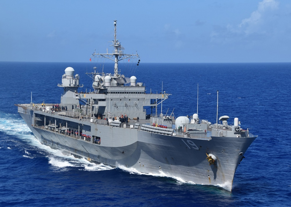 U.S. 7th Fleet flag ship USS Blue Ridge (LCC 19) steams in the Philippine Sea before conducting a replenishment-at-sea with the Lewis and Clark-class dry cargo and ammunition ship USNS Richard E. Byrd (T-AKE 4). (U.S. Navy photo by Charles Baker)