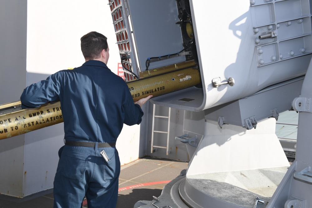 Fire Controlman 3rd Class Caleb Gallaher, from Portsmouth, Virginia, assigned to USS Gerald R. Ford's (CVN 78) combat systems department, unloads a rolling airframe training missile on Ford's (RAM) weapon sponson April 2, 2020, after completing sea based developmental testing (SBDT) of the integrated combat system.