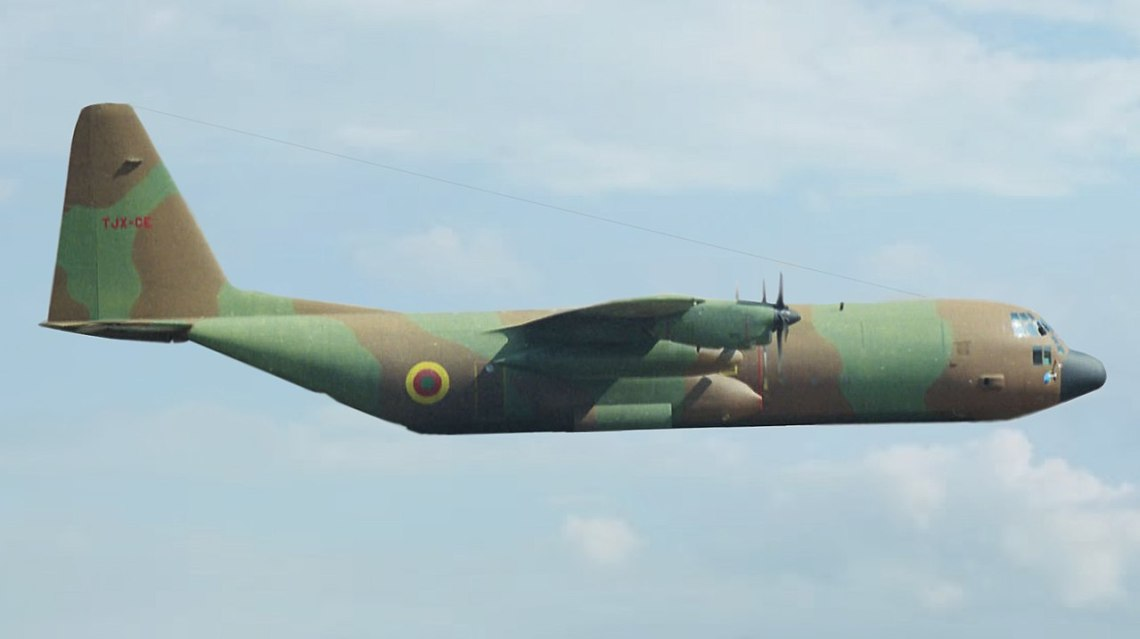 Cameroon Air ForceC-130H TJX-CE modified in flight (Photo by Bob Adams )