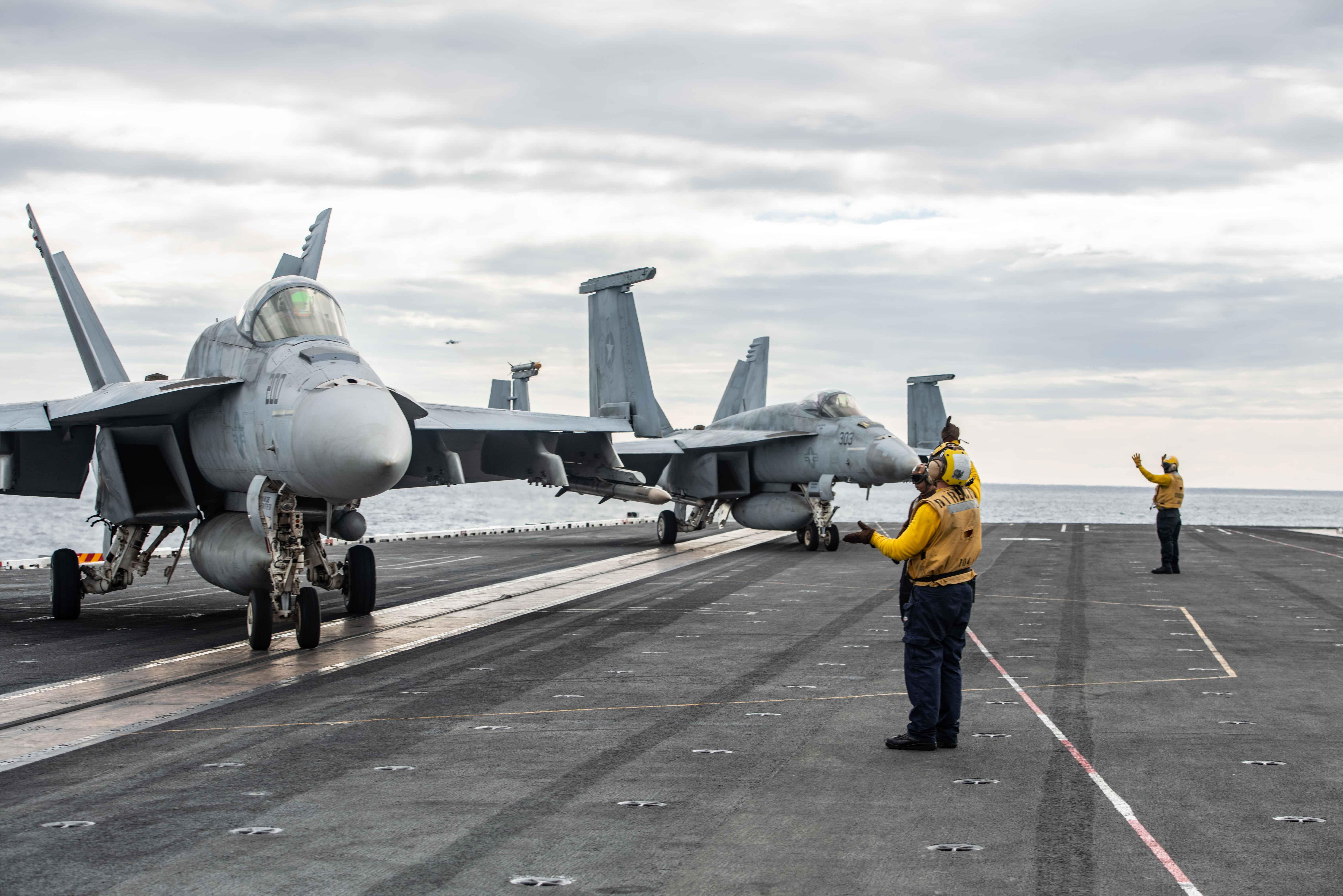 U.S. Navy F/A-18E Super Hornets with AN/ASQ-228 ATFLIR pods.