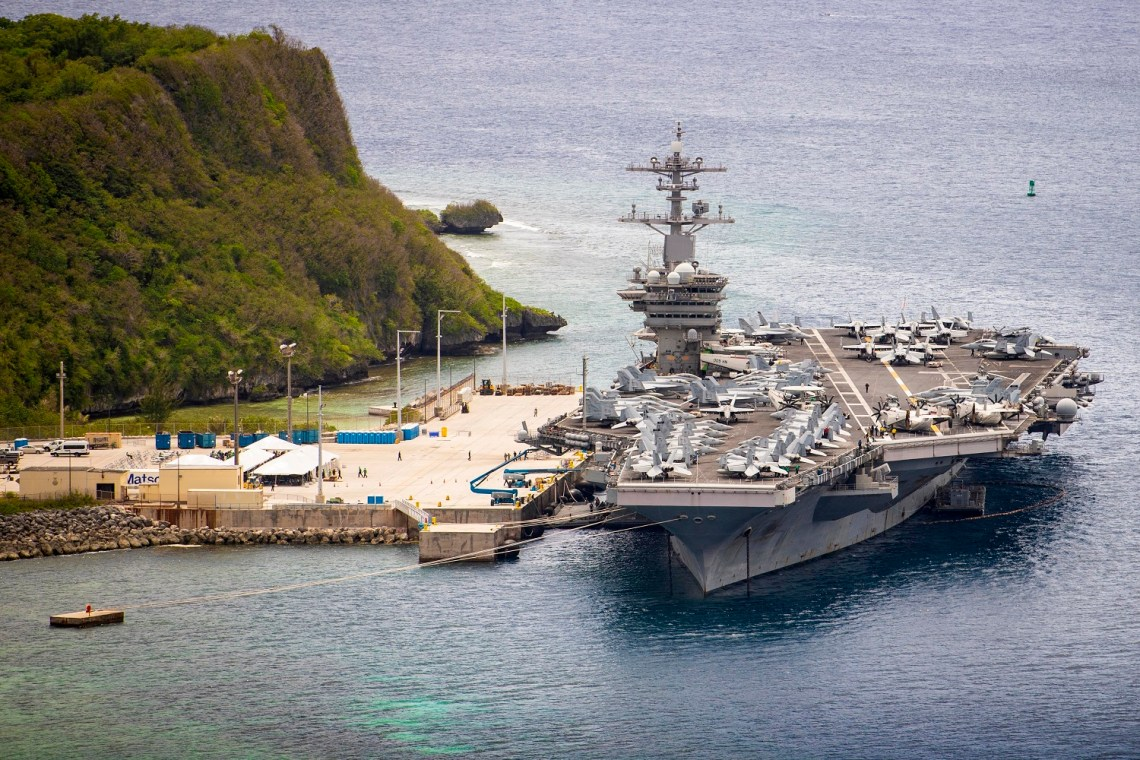 The aircraft carrier USS Theodore Roosevelt (CVN 71) is moored pier side at Naval Base Guam May 15, 2020. Theodore Roosevelt's COVID-negative crew returned from quarantine beginning on April 29 and is making preparations to return to sea to continue their scheduled deployment to the Indo-Pacific. (U.S. Navy photo by Mass Communication Specialist 3rd Class Conner D. Blake)