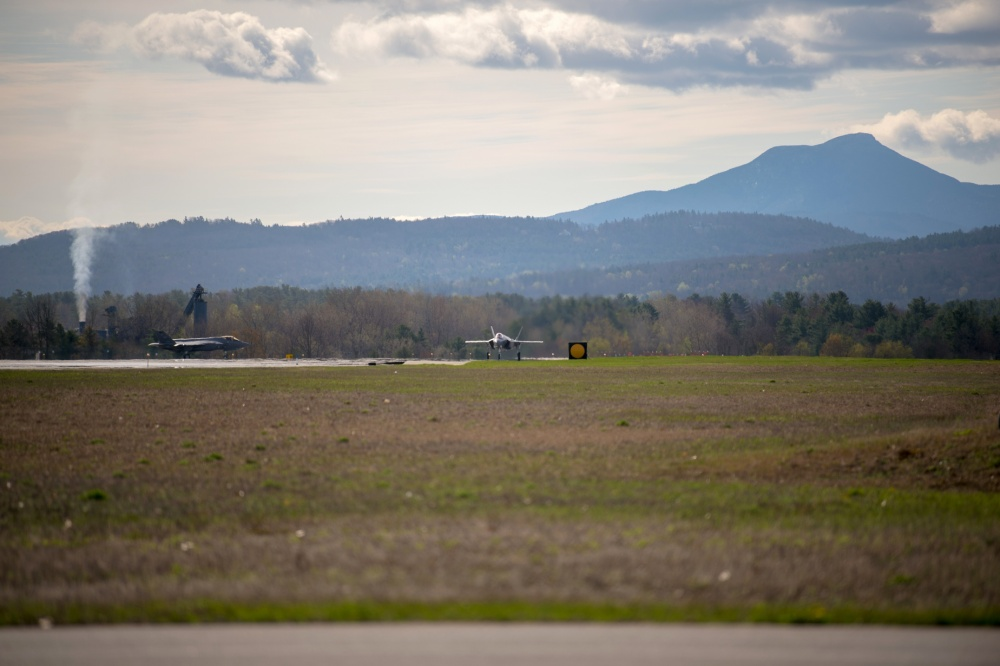 Two F-35 Lightning IIs approach the runway at the Vermont Air National Guard Base, South Burlington, Vt., May 6, 2020. Maj. Michael Cady, chief of weapons and tactics for the 134th Fighter Squadron, Vermont Air National Guard, was piloting the Tail 5278 which achieved the 500th sortie for the Green Mountain Boys. (U.S. Air National Guard photo by Miss Julie M. Shea)