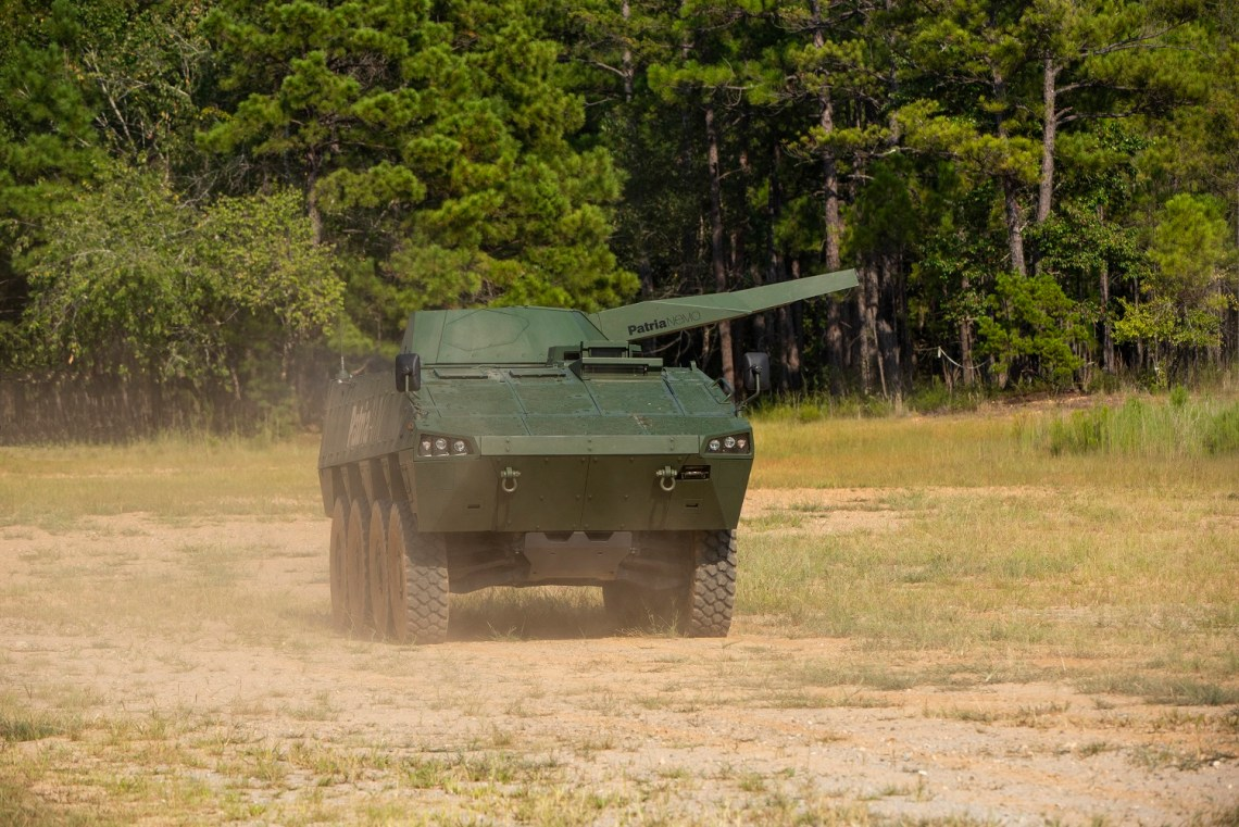 Spectators gather to watch the Patria Nemo 120mm mortar turret demonstration Sept 11, 2019 at Red Cloud Range on post. (U.S. Army photo by Patrick A. Albright, Fort Benning Maneuver Center of Excellence photographer)