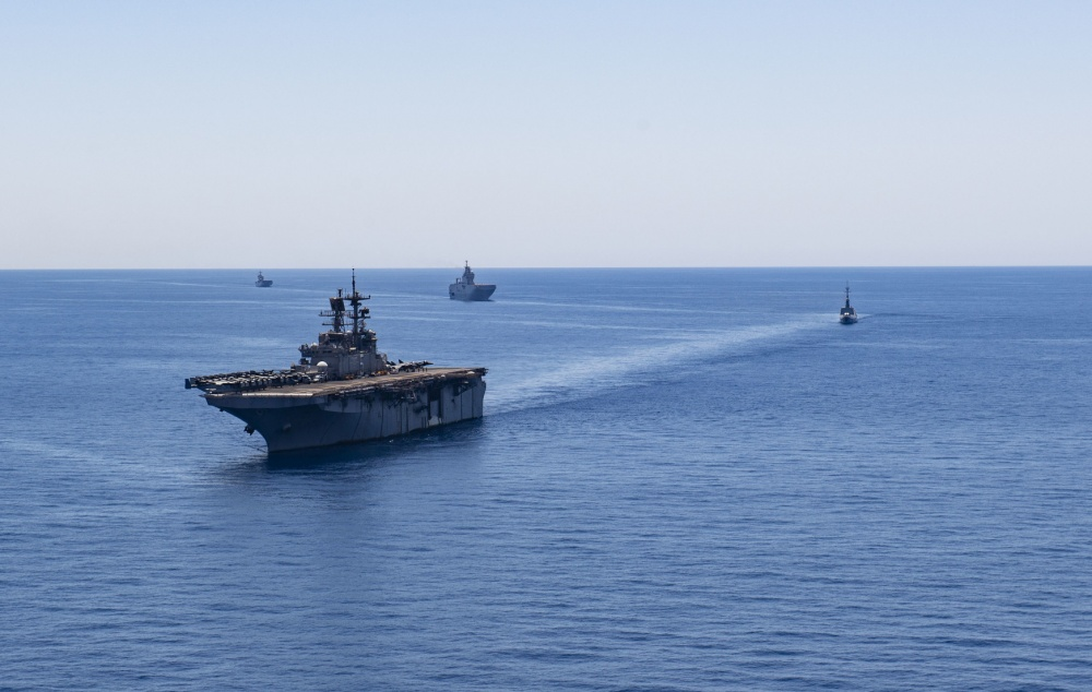 The Wasp-class amphibious assault ship USS Bataan (LHD 5), front, sails in formation with, from right to left, the French frigate FS Guepratte, the French amphibious assault ship FS Mistral and the Italian amphibious transport dock ship ITS San Giorgio, as part of a maritime training exercise, June 24, 2020. Bataan is conducting operations in U.S. 6th Fleet in support of regional allies and partners, and U.S. national security interests in Europe and Africa. (U.S. Navy photo by Mass Communication Specialist 2nd Class Anna Van Nuys/Released)