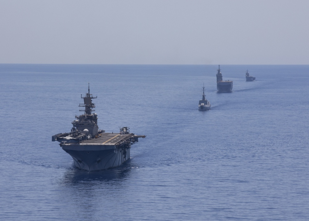 From left to right, the Wasp-class amphibious assault ship USS Bataan (LHD 5), the French frigate FS Guepratte, the French amphibious assault ship FS Mistral and the Italian amphibious transport dock ship ITS San Giorgio sail in formation as part of a maritime training exercise, June 24, 2020. Bataan is conducting operations in U.S. 6th Fleet in support of regional allies and partners, and U.S. national security interests in Europe and Africa. (U.S. Navy photo by Mass Communication Specialist 3rd Class Lenny Weston/Released)