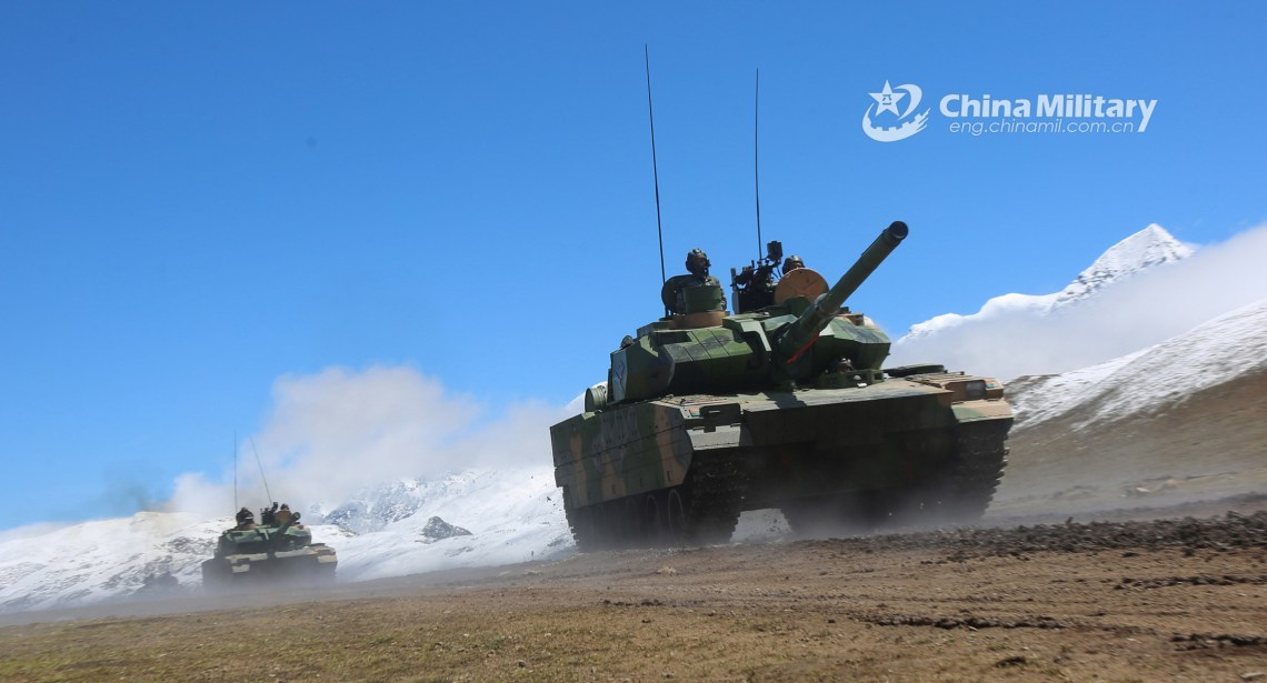 Type 15 Light Tanks attached to a combined arms brigade under the PLA Xizang Military Command maneuver in formation to a designated firing point during a live-fire training exercise in southwest China's Xizang Autonomous Region from June 8 to 11, 2020. (eng.chinamil.com.cn/Photo by Li Song)