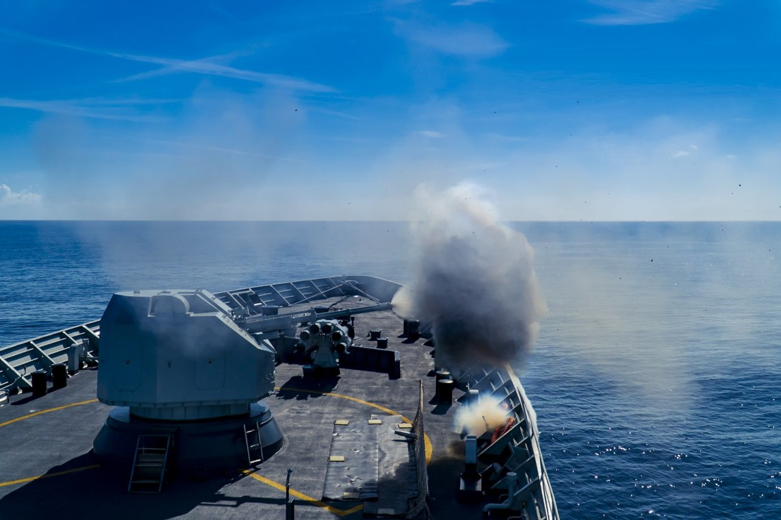 The guided-missile frigate Hengyang (Hull 568) attached to a destroyer flotilla with the navy under the PLA Southern Theater Command fires its main gun against mock ashore targets during a maritime live-fire training exercise in waters of the South China Sea on June 18, 2020. (eng.chinnmil.com.cn/Photo by Li Wei)