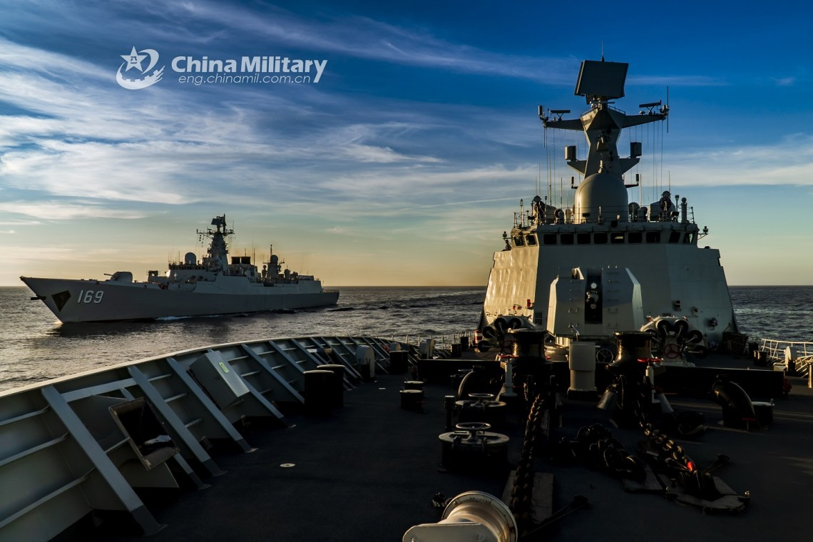 The guided-missile frigate Hengyang (Hull 568) and the guided-missile destroyer Wuhan (Hull 169) attached to a destroyer flotilla with the navy under the PLA Southern Theater Command steam alongside with each other during a maritime maneuver operation in waters of the South China Sea on June 18, 2020. (eng.chinnmil.com.cn/Photo by Li Wei)