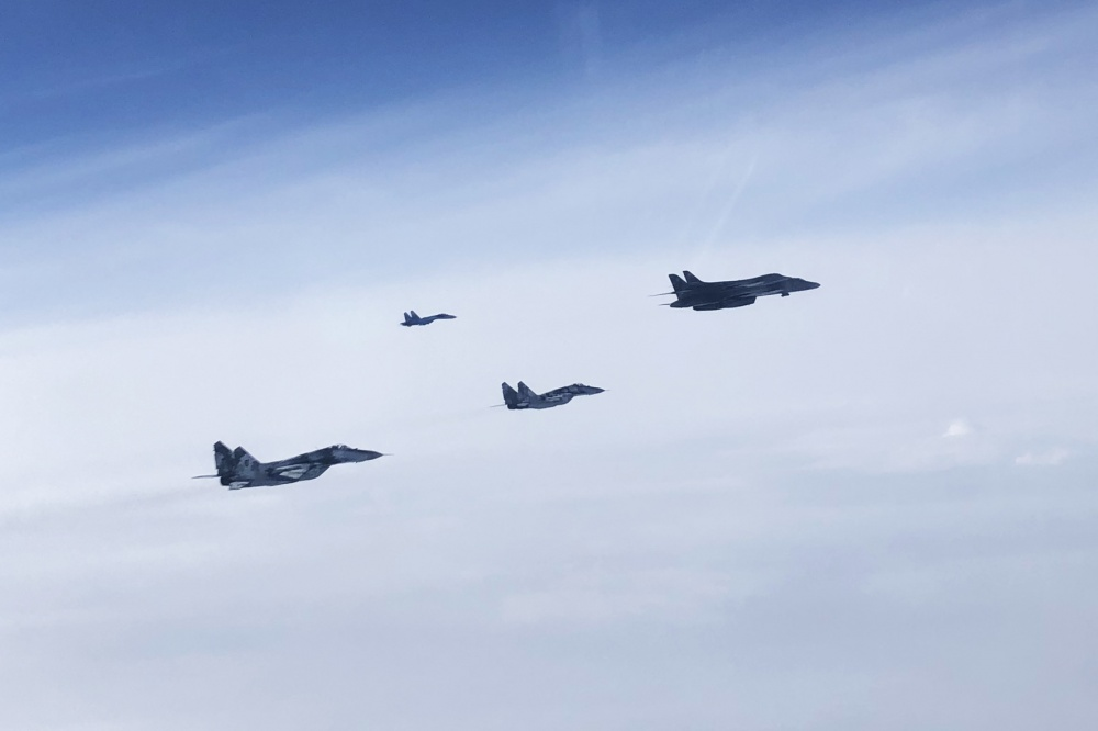 A Ukrainian Su-27 Flanker and MiG-29 Fulcrum escort two B1B Lancers during a training mission for Bomber Task Force Europe, May 29, 2020.
