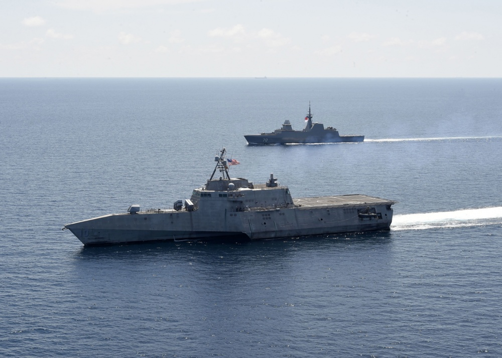The Independence-variant littoral combat ship USS Gabrielle Giffords (LCS 10), right, exercises with the Republic of Singapore Navy Formidable-class multi-role stealth frigate RSS Steadfast (FFS 70) in the South China Sea, May 25, 2020. Gabrielle Giffords, part of Destroyer Squadron Seven, is on a rotational deployment, operating in the U.S. 7th Fleet area of operations to enhance interoperability with partners and serve as a ready-response force. (U.S. Navy photo by Mass Communication Specialist 2nd Class Brenton Poyser)