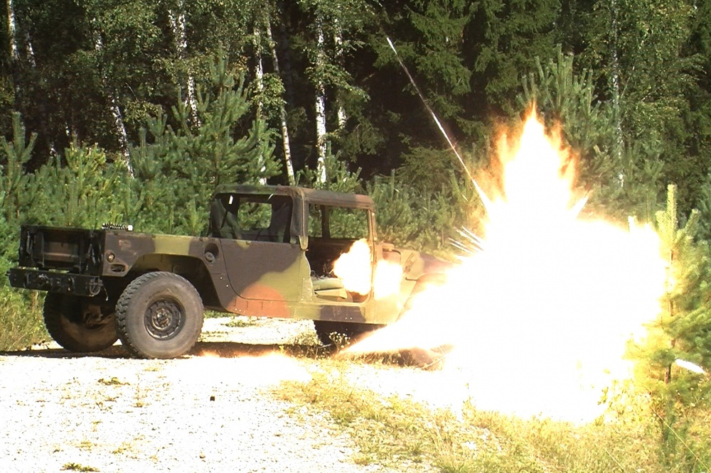 A Selectable Lightweight Attack Munition (SLAM) explodes on a target during the live fire portion of a SLAM class at the 7th Army Training Command's Grafenwoehr Training Area, Germany