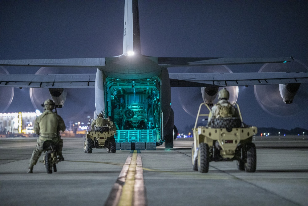 U.S. Air Force Special Tactics operators with the 320th Special Tactics Squadron out of Kadena Air Base, Japan, wait to load their vehicles into a C-130J Super Hercules during an engine running onload/offload (ERO) training as part of Exercise Gryphon Jet at Yokota Air Base, Japan, June 23, 2020.