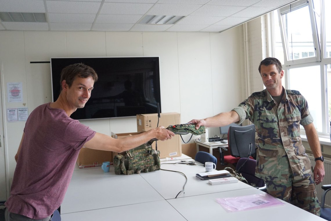 Elitac Wearables' Wouter Vos (l) hands over first Mission Navigation Belt order to Major Van Veen, Defence Centre of Expertise for Soldier and Equipment, Royal Netherlands Army (r), under COVID-19 distance rules