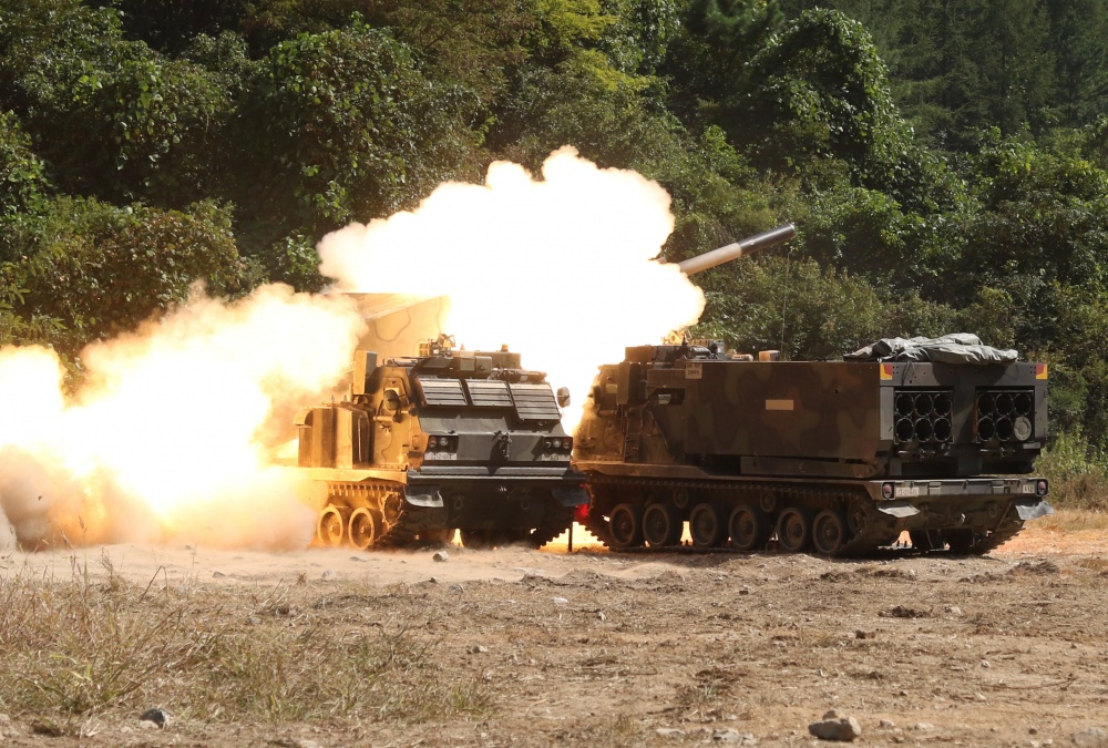 An M270 multiple launch rocket system fires during a live fire training exercise at Rocket Valley, South Korea. 2nd Battalion, 4th Field Artillery Regiment , 210th Field Artillery Brigade, 2nd Infantry Division ROK-US Combined Division, certified 16 crews in five hours as they completed their Table VI certification. (U.S. Army photo by Sgt. Michelle U. Blesam, 210th FA BDE PAO)