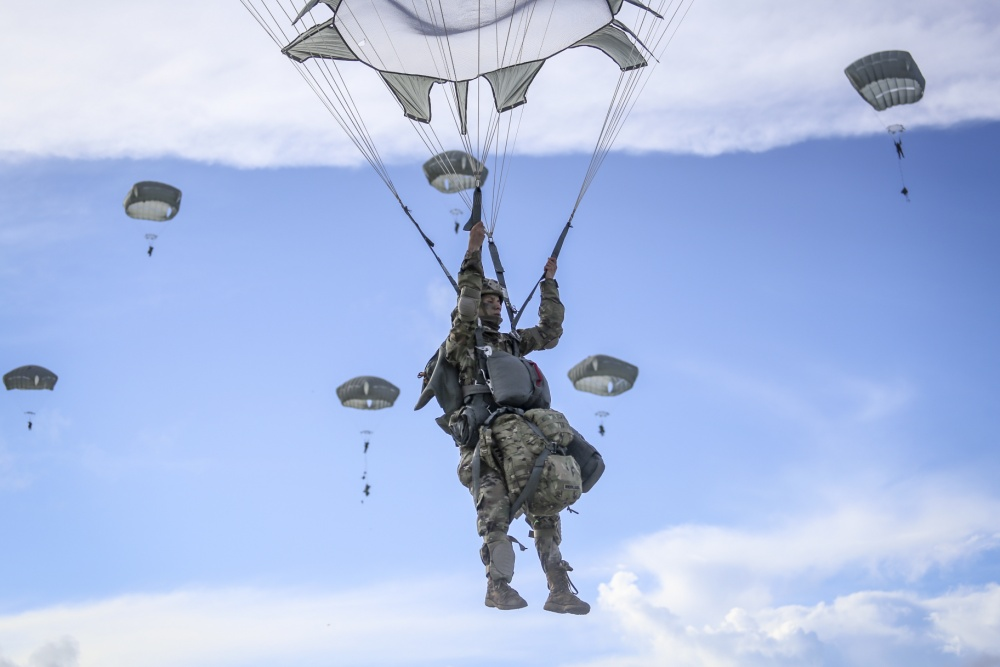Paratroopers from the 4th Brigade Combat Team (Airborne), 25th Infantry Division, jump from a C-17 onto Andersen Air Force Base Guam on June 30.
