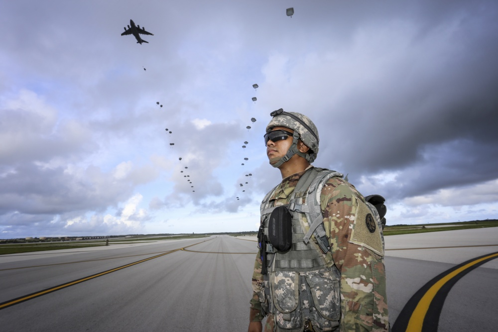 Pfc. Daron Foster of the Guam National Guard's 1-294th Infantry Regiment, awaits the arrival of over 400 paratroopers from the 4th Brigade Combat Team (Airborne), 25th Infantry Division on Andersen Air Force Base Guam on June 30.