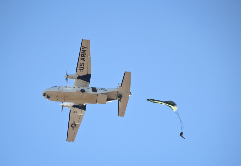 A paratrooper jumps from a CASA 212 212-200 aircraft, during Operation Toy Drop.