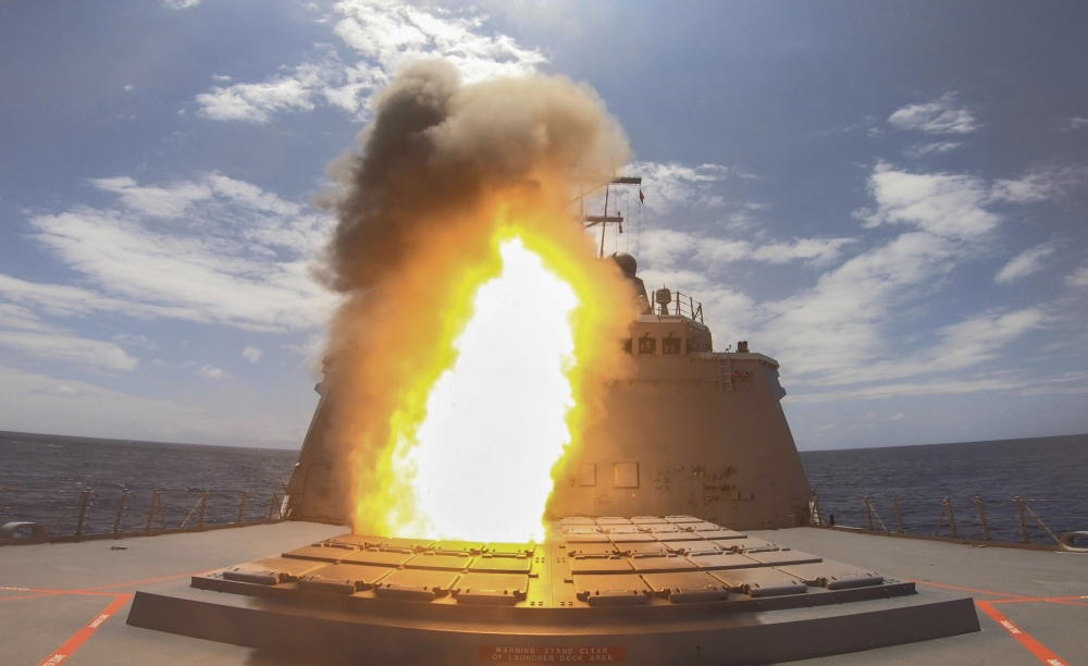 Royal Australian Navy ship HMAS Hobart executes a live missile firing off the coast of Hawaii during Exercise Rim of the Pacific.