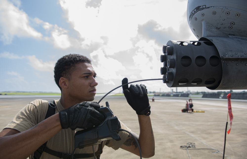 U.S. Air Force Senior Airman Anthony Knight, inserts a camera into the front of GAU-8 Avenger 30mm cannon on an A-10 Thunderbolt II to inspect for corrosion at Andersen Air Force Base, Guam, Aug. 17, 2020