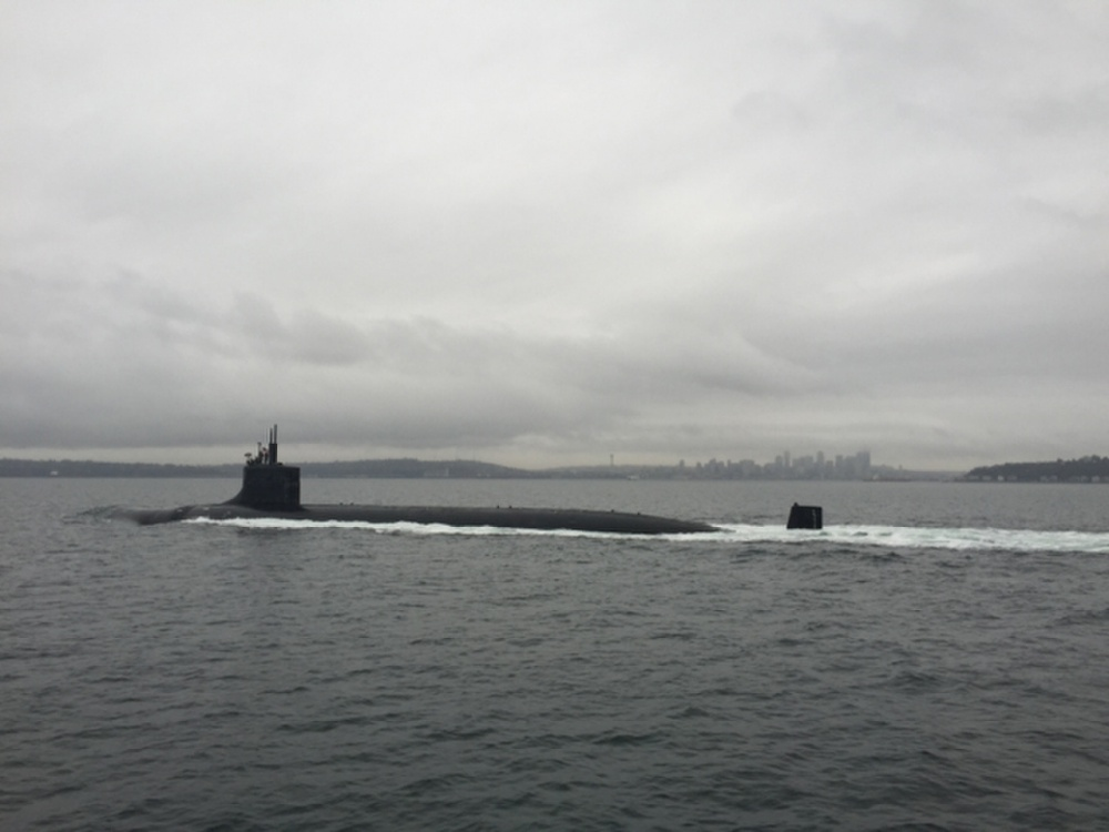 Fast-attack submarine USS Seawolf (SSN 21) transits through Washington state's Puget Sound after departing its home port of Naval Base Kitsap-Bremerton.