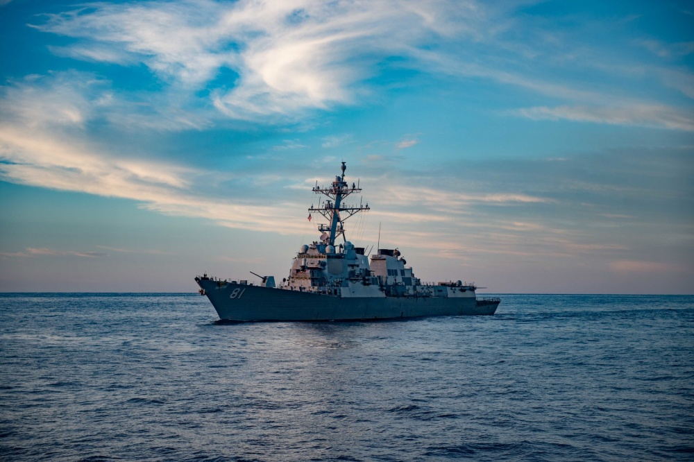 USS Winston S. Churchill (DDG 81) patrols the Atlantic waters at dusk. Churchill is conducting integrated training in the Atlantic Ocean.
