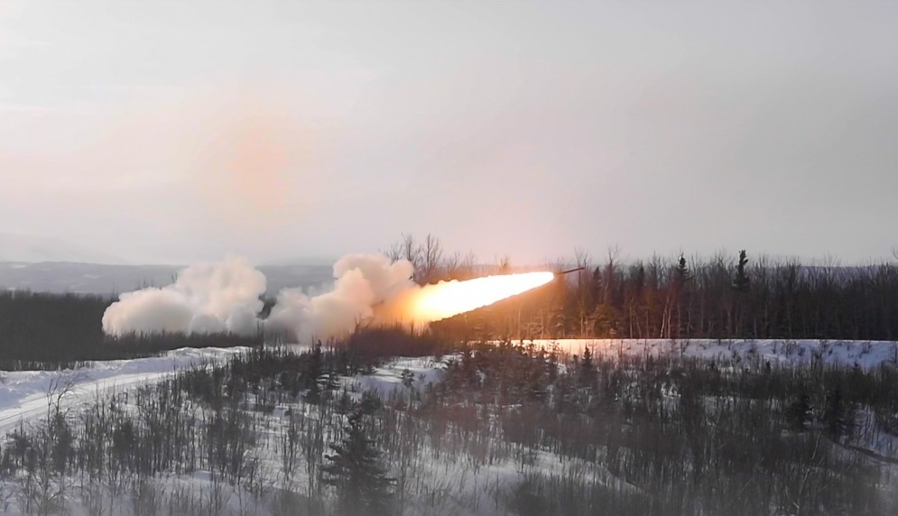 U.S. Marines from 5th Battalion, 11th Marine Regiment, shoot a M142 High Mobility Artillery Rocket System (HIMARS) during U.S. Northern Command's Exercise Arctic Edge, Fort Greely, Alaska, Mar. 3, 2020.